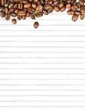Coffee beans on a sheet for notes Stock Image