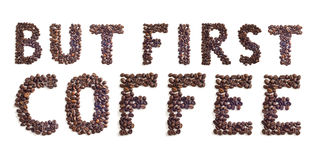 Coffee beans sign. `But first coffee made of coffee beans stock photos