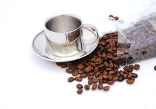 Coffee beans and silver cup Royalty Free Stock Images