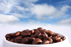 Coffee beans , sky and clouds Royalty Free Stock Images