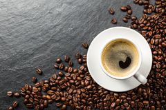 Coffee and beans on slate Stock Image