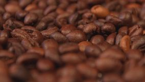 Coffee beans. Slow motion pan. Close-up. 2 shots stock video