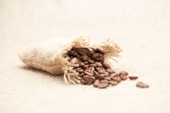 Coffee beans and small bag Stock Photo