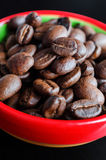 Coffee beans in a small bowl. Close up, selective focus Stock Photography
