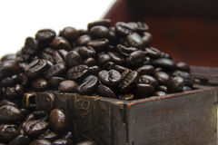 Coffee beans. In small chest on isolated white background Royalty Free Stock Images