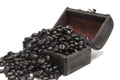 Coffee beans in small chest. On isolated white background Royalty Free Stock Photo