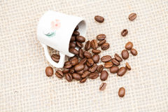 Coffee beans and small cup Royalty Free Stock Photo