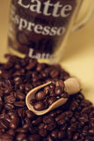 Coffee beans. With small measuring spoon made of wood Royalty Free Stock Images