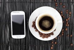 Coffee with beans and smart phone Stock Image