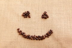 Coffee beans with a smile shape Royalty Free Stock Photo