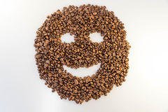 Coffee beans smiley face. Close up of coffee beans in shape of a smiley face royalty free stock image