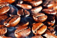 Coffee beans with smoke. Macro Stock Image