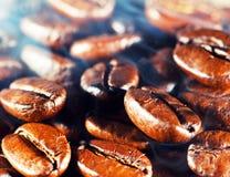 Coffee beans with smoke. Macro Stock Photography