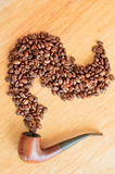 Coffee beans and smoking pipe Stock Photo