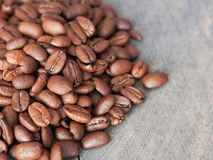 Coffee beans. Some coffee beans on a board Stock Photography