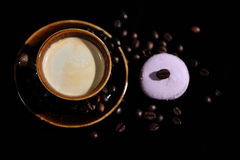 Coffee beans and some cakes. Coffee beans and some dessert, one macaron cake Royalty Free Stock Photography