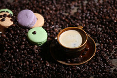 Coffee beans and some dessert. Macarons cake Stock Images