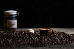 Coffee beans and some dessert. Macarons cake stock photos