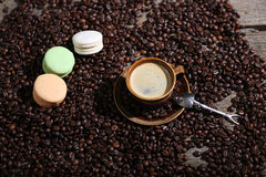 Coffee beans and some dessert. Macarons cake Stock Image