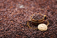 Coffee beans and some dessert. One macaron cake stock photography