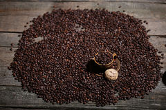 Coffee beans and some dessert Royalty Free Stock Image