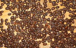 Coffee beans. Some coffee beans on the floor Royalty Free Stock Images