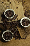 Coffee beans. Some coffee beans in the kitchen interior Stock Photos