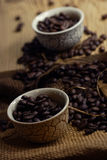 Coffee beans. Some coffee beans in the kitchen interior Stock Image