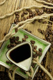 Coffee beans. Some coffee beans in the kitchen interior Stock Photography