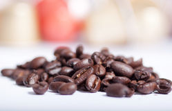 Coffee beans. Some coffee beans on white background Royalty Free Stock Photo