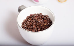 Coffee beans. Some coffee beans on white background Royalty Free Stock Image