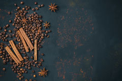 Coffee beans with spices anise and cinnamon sticks on rusty stone surface with free space Stock Photo