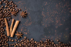 Coffee beans with spices anise and cinnamon sticks on rusty stone surface with free space Royalty Free Stock Photography