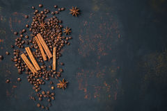 Coffee beans with spices anise and cinnamon sticks on rusty stone surface with free space Royalty Free Stock Image