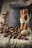 Coffee beans with spices and cezve Royalty Free Stock Photography