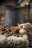 Coffee beans with spices and cezve Royalty Free Stock Photos
