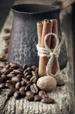 Coffee beans with spices and cezve Royalty Free Stock Photo