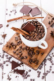 Coffee beans, spices and chocolate over white background Royalty Free Stock Photography