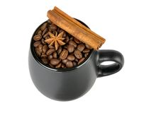 Coffee beans and spices in a mug Stock Images