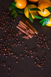Coffee beans with spices on the old wooden boards. , cinnamon, nuts, star anise Stock Images