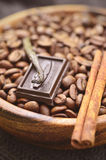 Coffee beans with spices in a wooden bow. L,tinted photo Royalty Free Stock Images