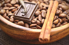 Coffee beans with spices in a wooden bowl. Coffee beans with spices in a wooden bowl,tinted photo Stock Images