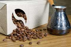 Coffee beans spill out of the box Royalty Free Stock Photo