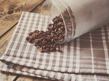 Coffee Beans Spilled on Gray and White Plaid Textile Royalty Free Stock Image