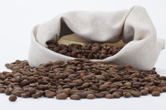 Coffee beans spilled out of the bag. Coffee beans spilled out of the jute bag Royalty Free Stock Photography