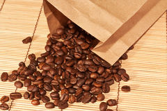 Coffee beans spilled out of the bag Stock Photography