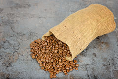 Coffee beans spilled out of the bag Royalty Free Stock Photo