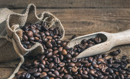 Coffee Beans Spilled out of Burlap Sack Royalty Free Stock Image