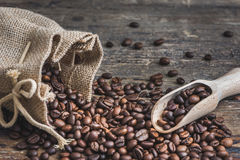 Coffee Beans Spilled out of Burlap Sack Stock Photo