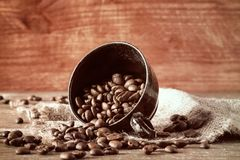 Coffee beans spilled out of a cup Stock Image
